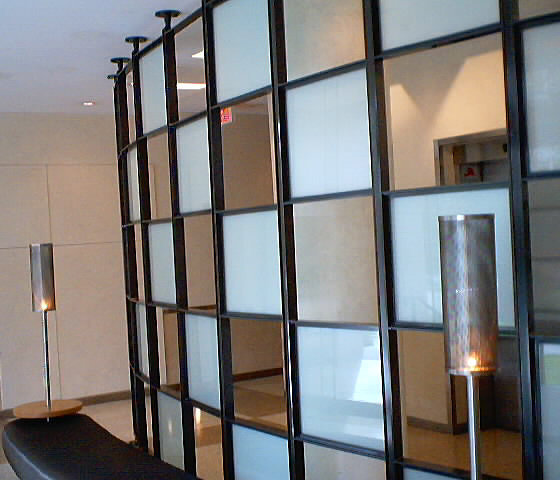 Glass Wall With Elevators Behind!