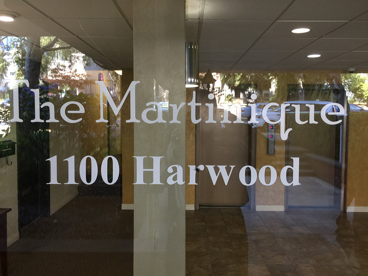 1100 Harwood Entrance Door With Sign!