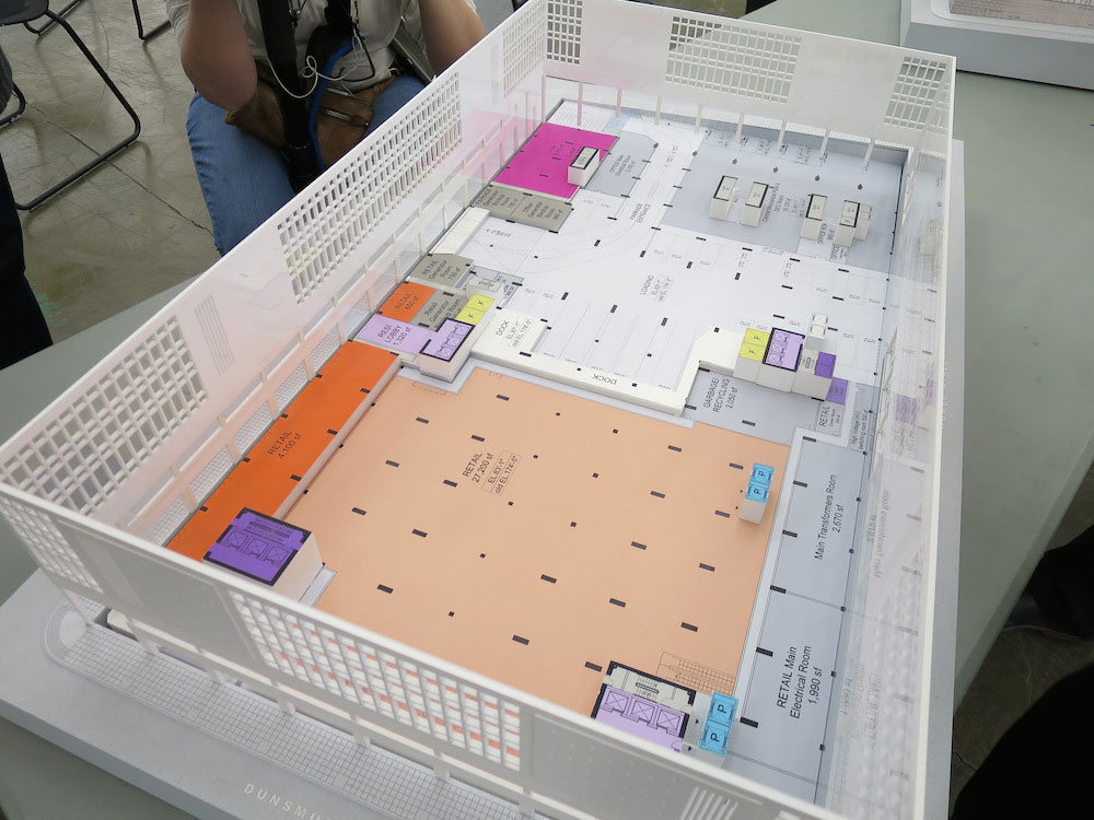Diagram model of the first floor of showing retail (light orange and orange).!