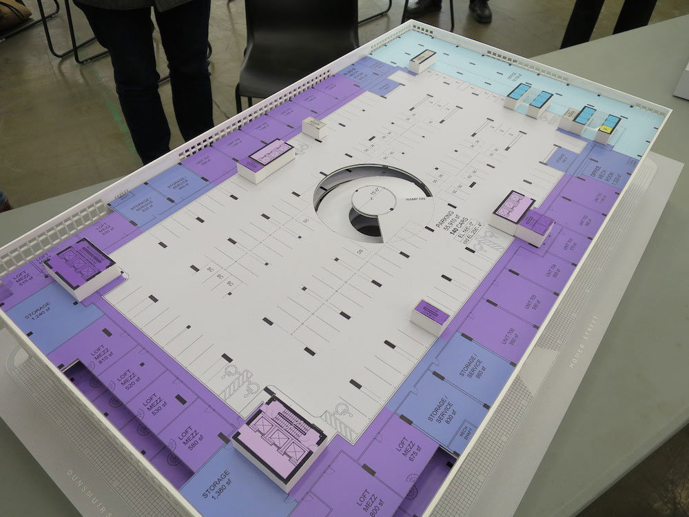 Diagram model of the sixth floor showing parking (grey), residential units (purple), and office space (blue).!