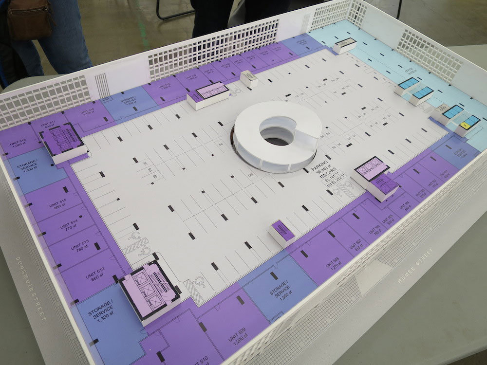Diagram model of the sixth floor with the up-spiral access ramp (centre), parking (grey), residential units (purple), and office space (blue).!